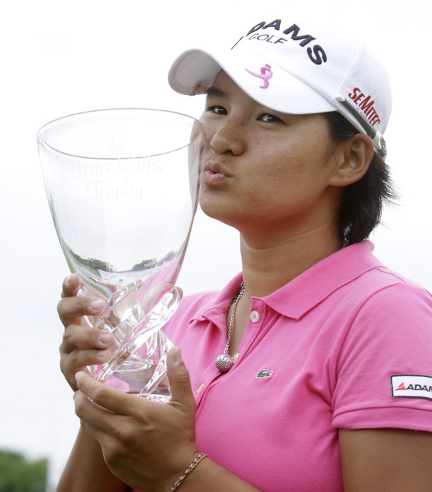 Yani Tseng of Taiwan kisses the Bruce Callis trophy on the 18th green after winning the LPGA State Farm Classic golf tournament Sunday, June 12, 2011, in Springfield, Ill.