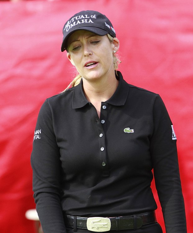 Cristie Kerr shows her disappointment after missing a putt for birdie on the 18th green of the LPGA State Farm Classic golf tournament Sunday, June 12, 2011, in Springfield, Ill. Kerr finished second.
