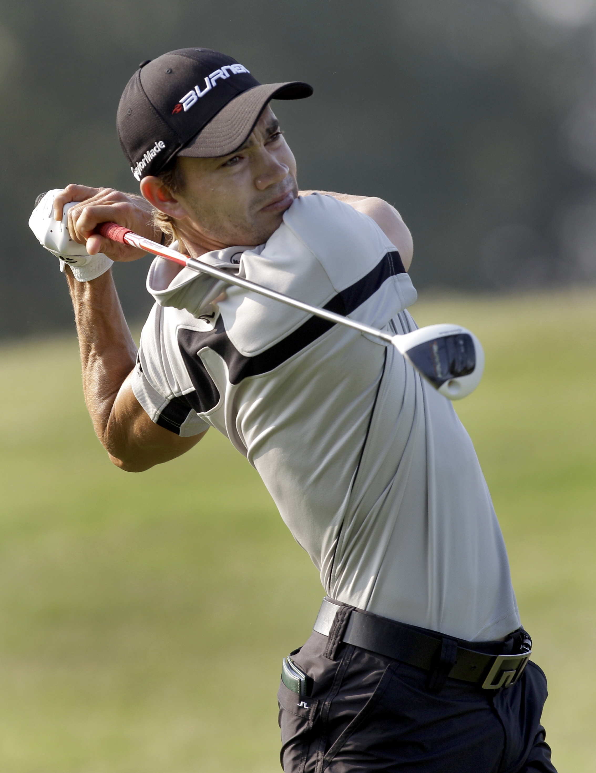Camilo Villegas, of Colombia, tees off on the second hole during the first round of the St. Jude Classic golf tournament Thursday, June 9, 2011, in Memphis, Tenn.