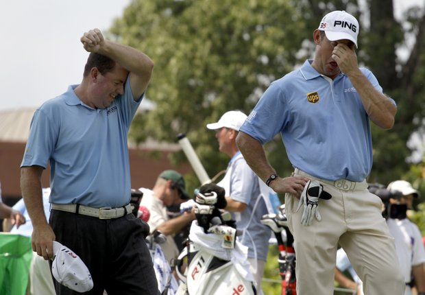 Robert Garrigus, left, and Lee Westwood, of England, try to keep cool before teeing off on the eighth hole during the first round of the St. Jude Classic golf tournament Thursday, June 9, 2011, in Memphis, Tenn.