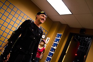 PGA Tour and European PGA Tour star Ian Poulter looks at himself in a mirror after being suited prior to his motion-capture session for the making of EA Sports' Tiger Woods '13 in Orlando, Fla. on June 8, 2011. Poulter's session, which included an extensive photo session and interview, lasted nearly 2 hours, including 150 motion captures of his swing.