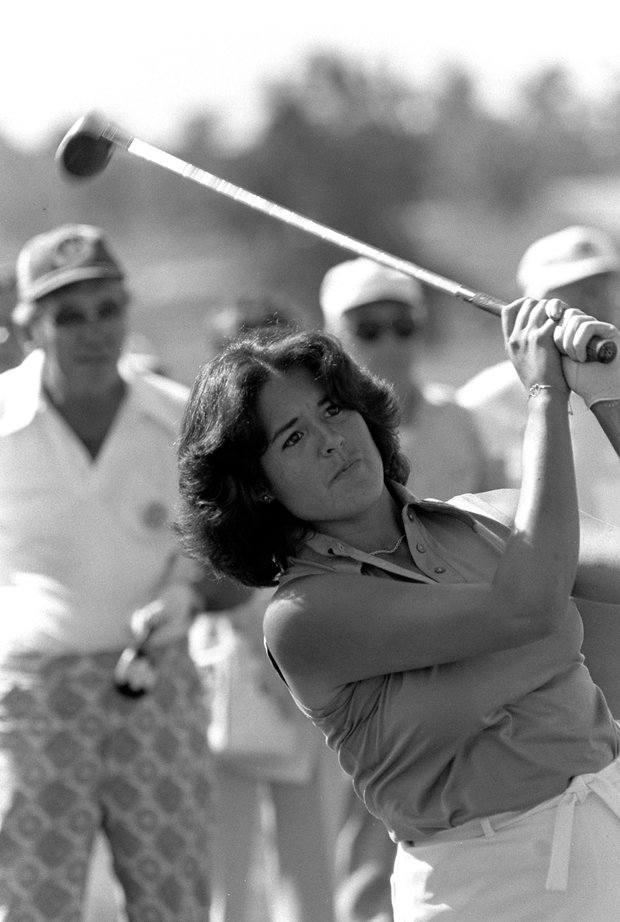 Nancy Lopez, leading money winner on the LPGA, keeps her eye on the ball as she drives off 17th tee during the Pro-Am Rail Charity Tournament Thursday, Aug. 31, 1978.