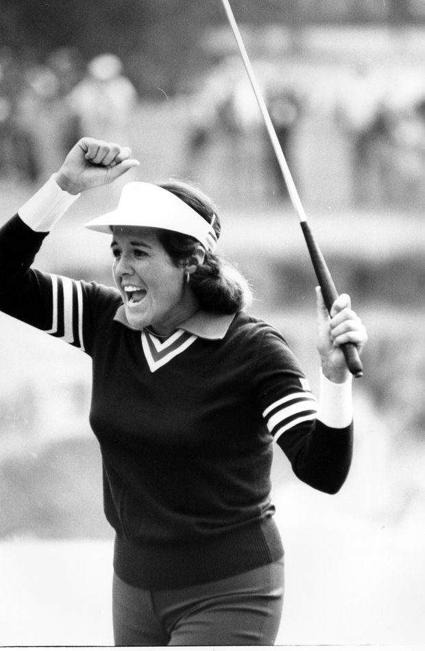 Nancy Lopez raises her arms in victory after she sank a 10-foot birdie putt on the second hole of a five-way sudden death playoff clinching victory in a $100,000 LPGA in Clifton, N.J. on May 20, 1979. The 22-year-old Lopez defended her title in the tournament with the win.