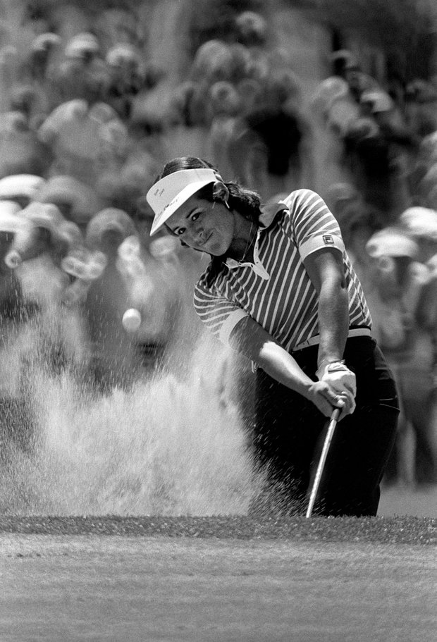 Golfer Nancy Lopez blasts out of the sand on the ninth hole during the third round of the Dinah Shore Winners Circle Golf Championship at Palm Springs, Calif., on Saturday, April 7, 1979. Lopez shot a 68 for the day.