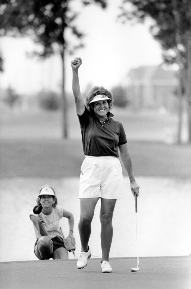 Pro golfer Nancy Lopez raises a clenched fist in victory after sinking her final putt on the 18th hole to win the LPGA Mazda Hall of Fame Championship at Sweetwater Country Club in Sugarland, Texas, on Sunday, July 7, 1985. Lopez birdied four of the final seven holes to finish 7 strokes under par 281.