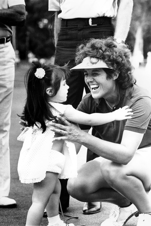 Pro golfer Nancy Lopez gets a hug from her 20-month-old daughter, Ashley Marie, after winning the LPGA Mazda Hall of Fame Championship at Sweetwater Country Club in Sugarland, Texas, on July 7, 1985. Lopez won by three strokes, finishing 7-under-par 281 for the 72 hole event.