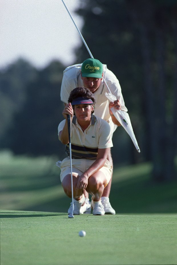 Nancy Lopez of Naples, Fla., lines up a putt on the 18th hole as her caddy, Tom Thorpe, looks on at the Nippon MBS Classic Golf Tournament in Buena Park, Ca., Sunday, Sept. 24, 1989. Lopez finished 2-under-par to win the LPGA tournament, her 42nd career tournament win.