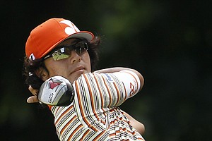 Ryo Ishikawa, of Japan, hits from the 17th tee during a practice round for the U.S. Open Championship golf tournament in Bethesda, Md., Tuesday, June 14, 2011.