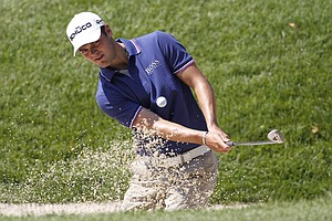 Martin Kaymer, of Germany, chips from a sandtrap to the practice green during a practice round for the U.S. Open Championship golf tournament in Bethesda, Md., Tuesday, June 14, 2011.