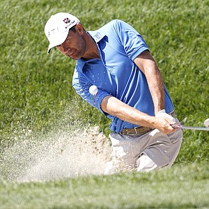 Padraig Harrington, of Ireland, chips from a sandtrap to the practice green during a practice round for the U.S. Open Championship golf tournament in Bethesda, Md., Tuesday, June 14, 2011.