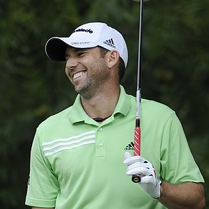 Sergio Garcia, of Spain, laughs while waiting to hit on the 16th tee during a practice round for the U.S. Open Championship golf tournament in Bethesda, Md., Tuesday, June 14, 2011.