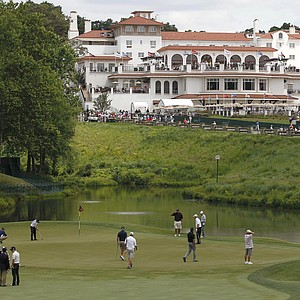Golfers practice on the 18th green of the Congressional Country Club during a practice round for the U.S. Open Championship golf tournament in Bethesda, Md., Tuesday, June 14, 2011. The clubhouse is in the background.