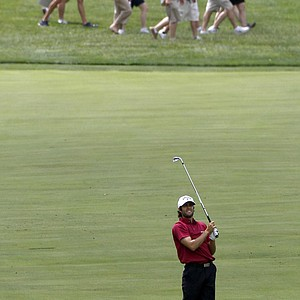 Adam Hadwin, of Canada, watches his fairway shot on the 15th hole during a practice round for the U.S. Open Championship golf tournament in Bethesda, Md., Tuesday, June 14, 2011.