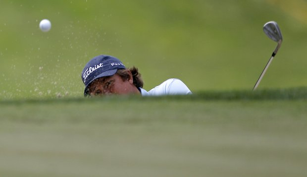 Jason Dufner hits out of a bunker to the 15th green during a practice round for the U.S. Open Championship golf tournament in Bethesda, Md., Tuesday, June 14, 2011.