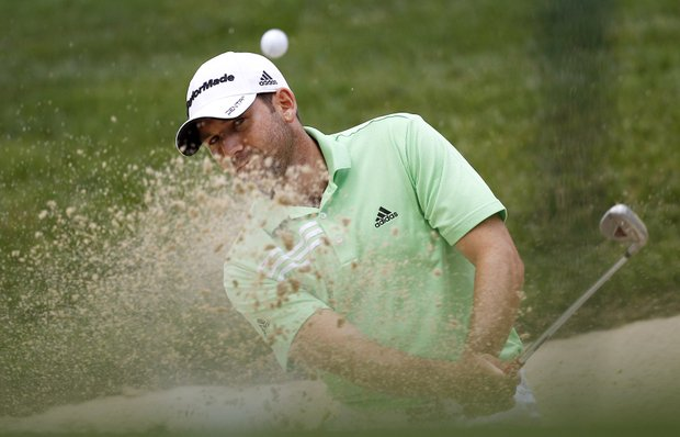 Sergio Garcia, of Spain, hits out of a bunker on the 15th hole during a practice round for the U.S. Open Championship golf tournament in Bethesda, Md., Tuesday, June 14, 2011.