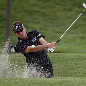 Ian Poulter, of England, chips out of the sand along the 18th fairway during a practice round for the U.S. Open Championship golf tournament in Bethesda, Md., Tuesday, June 14, 2011.