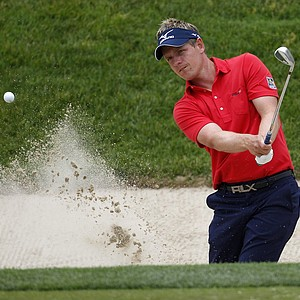 Luke Donald, of England, hits to the 11th green during a practice round for the U.S. Open Championship golf tournament in Bethesda, Md., Tuesday, June 14, 2011.