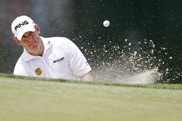 Lee Westwood, of England, hits out of the bunker on the 11th hole during a practice round for the U.S. Open Championship golf tournament in Bethesda, Md., Tuesday, June 14, 2011.