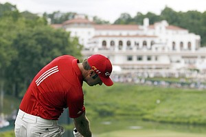 Dustin Johnson hits from the rough towards the 18th green during a practice round for the U.S. Open Championship golf tournament in Bethesda, Md. Tuesday, June 14, 2011.