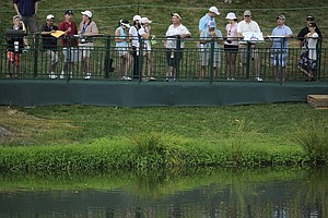 Fans line up along the 16th fairway to watch the practice round for the U.S. Open Championship golf tournament in Bethesda, Md., Tuesday, June 14, 2011.