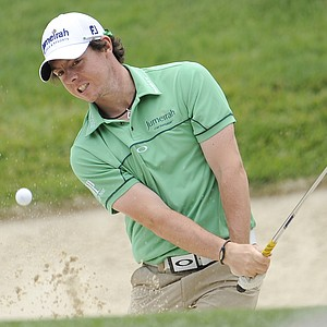 Rory McIlroy, of Northern Ireland, chips to the second green during a practice round for the U.S. Open Championship golf tournament in Bethesda, Md., Tuesday, June 14, 2011.