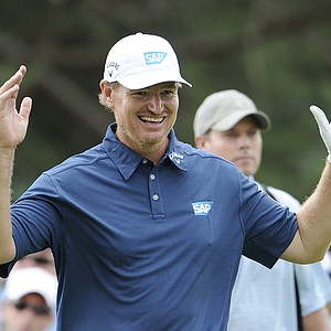 Ernie Els, of South Africa, reacts to his shot from the eight tee during a practice round for the U.S. Open Championship golf tournament in Bethesda, Md., Tuesday, June 14, 2011.