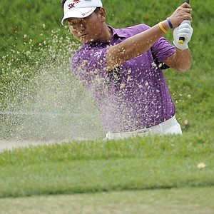 K. J. Choi. of South Korea, hits out of the bunker on the practice green during a practice for the U.S. Open Championship golf tournament in Bethesda, Md., Tuesday, June 14, 2011.