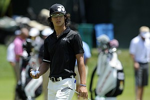 Ryo Ishikawa from Japan is seen during a practice round for the US Open Championship golf tournament in Bethesda, Md. Monday, June 13, 2011.