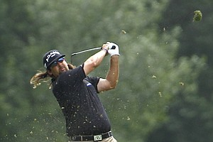 Andres Gonzales watches a shot during a practice round for the U.S. Open golf tournament in Bethesda, Md., Monday, June 13, 2011.