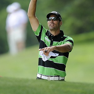 Alvaro Quiros, of Spain, gestures during a practice round for the U.S. Open golf tournament in Bethesda, Md., Monday, June 13, 2011.