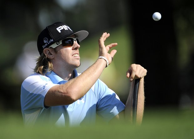 Hunter Mahan catches a ball on the 6th green during a practice round for the U.S. Open Championship golf tournament in Bethesda, Md., Tuesday, June 14, 2011.
