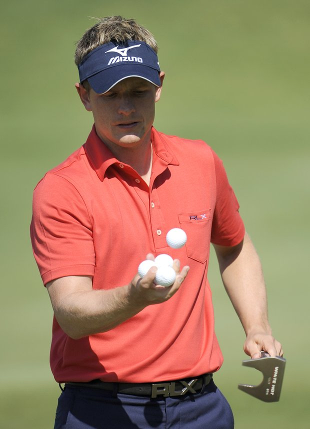 Luke Donald, of England, juggles his golf balls on the practice green before a practice round for the U.S. Open Championship golf tournament in Bethesda, Md., Tuesday, June 14, 2011.