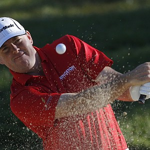 Robert Garrigus hits out of the bunker of the 11th hole during a practice round for the U.S. Open Championship golf tournament in Bethesda, Md., Wednesday, June 15, 2011.