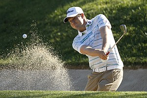 Nick Watney hits out of the bunker on the 11th hole during a practice round for the U.S. Open Championship golf tournament in Bethesda, Md., Wednesday, June 15, 2011.