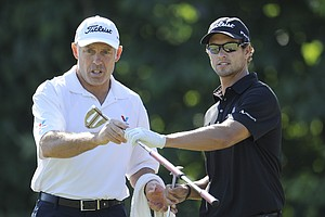Adam Scott, from Australia, right, talks with his caddie Steve Williams, during a practice round for the U.S. Open Championship golf tournament in Bethesda, Md., Wednesday, June 15, 2011. Williams is usually Tiger Woods caddy, who is not particiapting in the tournament.