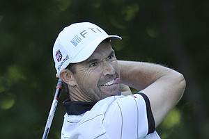 Padraig Harrington, of Ireland, hits from the 14th tee during a practice round for the U.S. Open Championship golf tournament in Bethesda, Md., Wednesday, June 15, 2011.