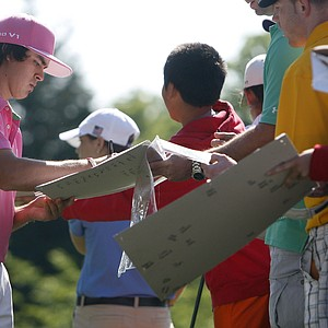 Rickie Fowler signs autographs before a practice round for the U.S. Open Championship golf tournament, in Bethesda, Md., Wednesday, June 15, 2011.