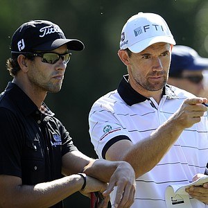 Adam Scott, of Australia, left, and Padraig Harrington, of Ireland, look over the 14th green during a practice round for the U.S. Open Championship golf tournament in Bethesda, Md., Wednesday, June 15, 2011.