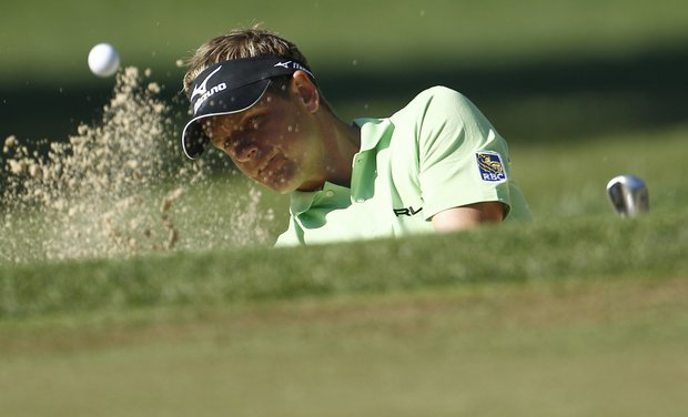 Luke Donald, of England, hits onto the fourth green during a practice round for the U.S. Open Championship golf tournament in Bethesda, Md., Wednesday, June 15, 2011.
