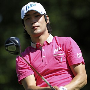 Kim Dae-hyun, of South Korea, watches his drive from the 16th tee during a practice round for the U.S. Open Championship golf tournament in Bethesda, Md., Wednesday, June 15, 2011.