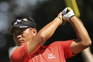 K.J. Choi, of South Korea, watches his shot from the 16th tee during a practice round for the U.S. Open Championship golf tournament in Bethesda, Md., Wednesday, June 15, 2011.