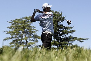 Martin Kaymer, of Germany, watches his drive from the 15th tee during a practice round for the U.S. Open Championship golf tournament in Bethesda, Md., Wednesday, June 15, 2011.