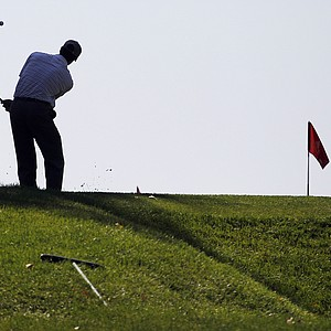 Bennett Blakeman,left, works on his swing on the practice green before a practice round for the U.S. Open Championship golf tournament in Bethesda, Md., Wednesday, June 15, 2011.