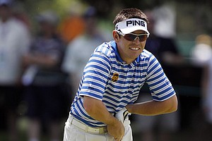 Louis Oosthuizen, of South Africa, watches his drive from the 12th tee during a practice round for the U.S. Open Championship golf tournament in Bethesda, Md., Wednesday, June 15, 2011.