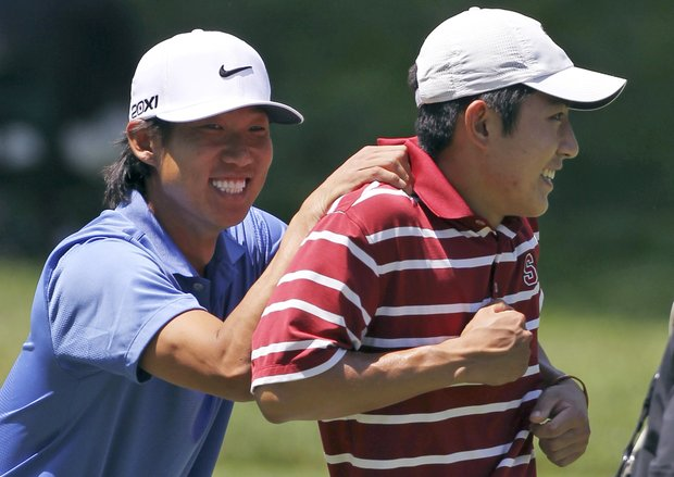 Anthony Kim, left, and David Chung joke around as they walk up the 12th fairway during a practice round for the U.S. Open Championship golf tournament in Bethesda, Md., Wednesday, June 15, 2011.