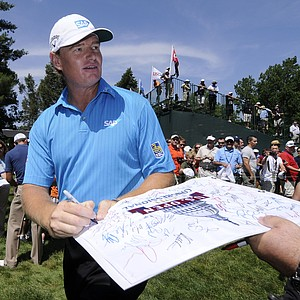 Ernie Els, of South Afirca, signs autographs between the 15th and 16th holes during practice before the U.S. Open Championship golf tournament in Bethesda, Md., Wednesday, June 15, 2011.