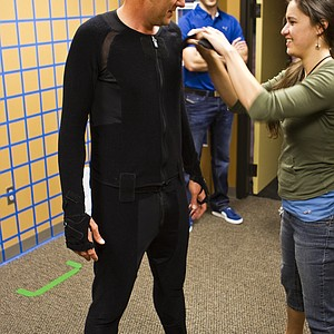 Ian Poulter in the motion-capture suit and having tiny little balls placed strategically on the suit so that the cameras can pick up his every movement.