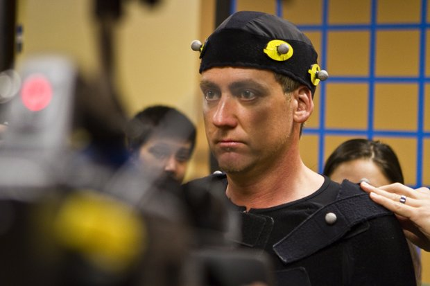 Ian Poulter stares intently at a mirror, taking in his skin-tight, motion-capture uniform for a session with EA Sports.