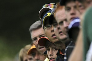 Golf fans watch the play along the second fairway during the first round of the U.S. Open Championship golf tournament in Bethesda, Md., Thursday, June 16, 2011.