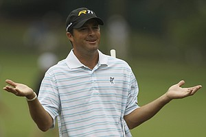 Ryan Palmer reacts to his approach shot to the fourth green during the first round of the U.S. Open Championship golf tournament in Bethesda, Md., Thursday, June 16, 2011.